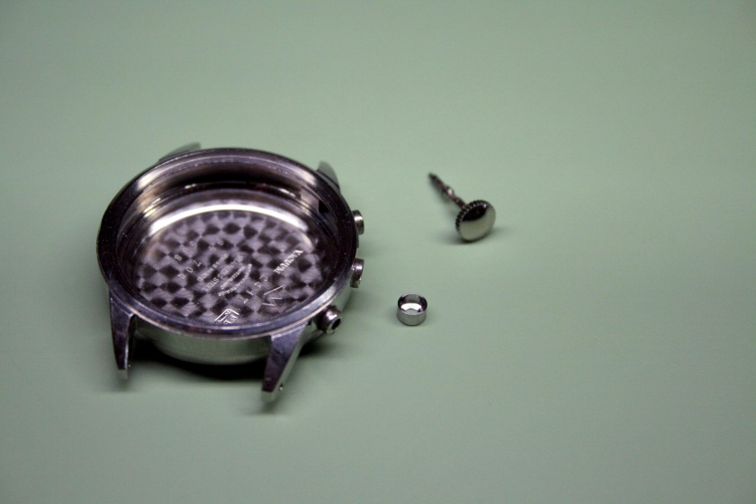 Damaged watch case with replacement pendant tube and stem
